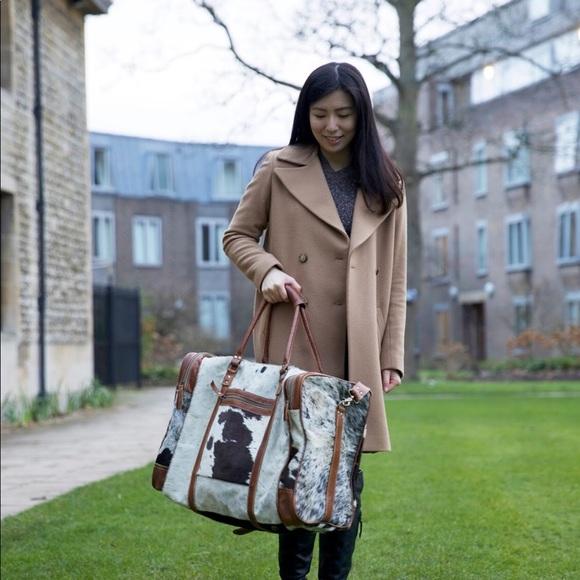 Myra Bag Bags Cowhide Duffle Bag Poshmark Myra bag cowhide purse handbag medium leather accents vintage fashion. poshmark